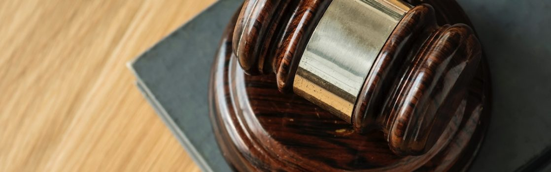 a judges gavel representing employee lawsuit costs